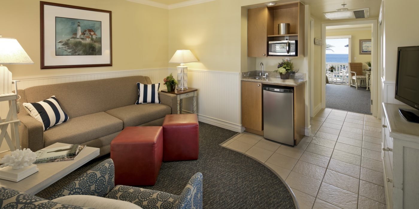 Suite Living Room with Kitchenette at Avila Lighthouse Suites