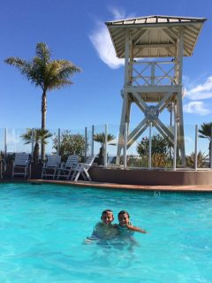 Kids playing at Avila Lighthouse Suites outdoor pool